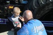 Hooked driver signs shirt at Monster Jam event