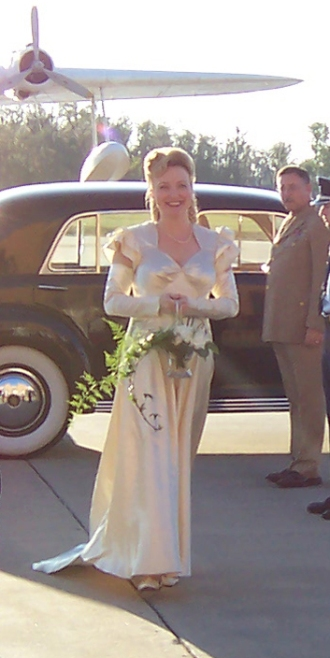 In my 1940s gown with my own Antique and Garden collection: A glass basket and white hydrangeas