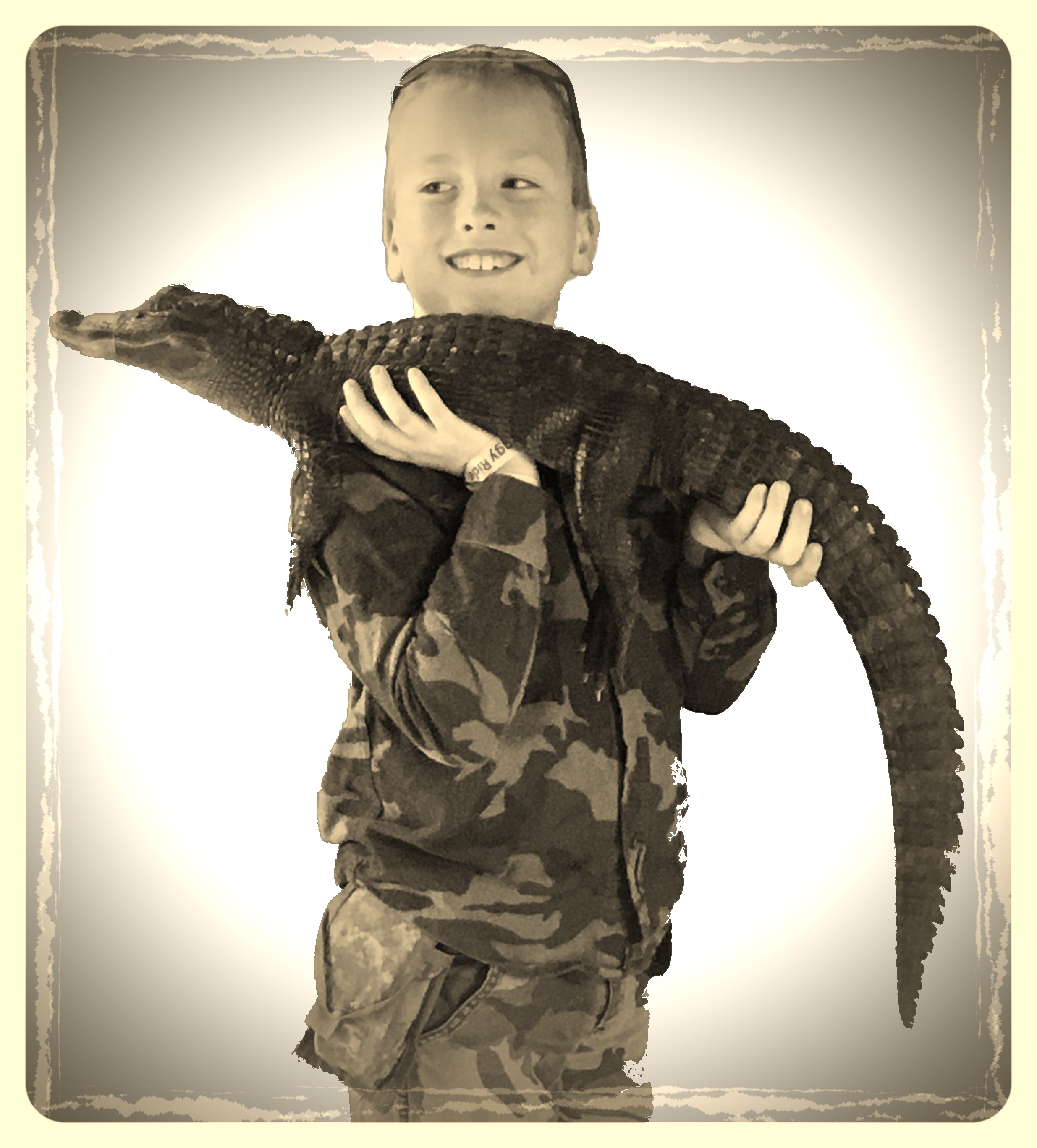Daniel holding a gator at Wild Florida. Photo by Kelly Green